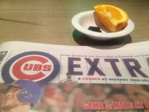 cubs, a prune, an orange segment